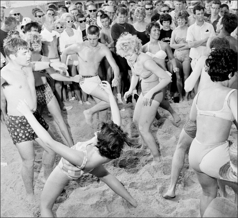 Teens, 1960s Teenagers twisting on the beach, Florida.