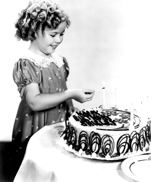 Shirley Temple, 1935. Apparently allowing children to play with matches wasn't a problem in the 1930s..!