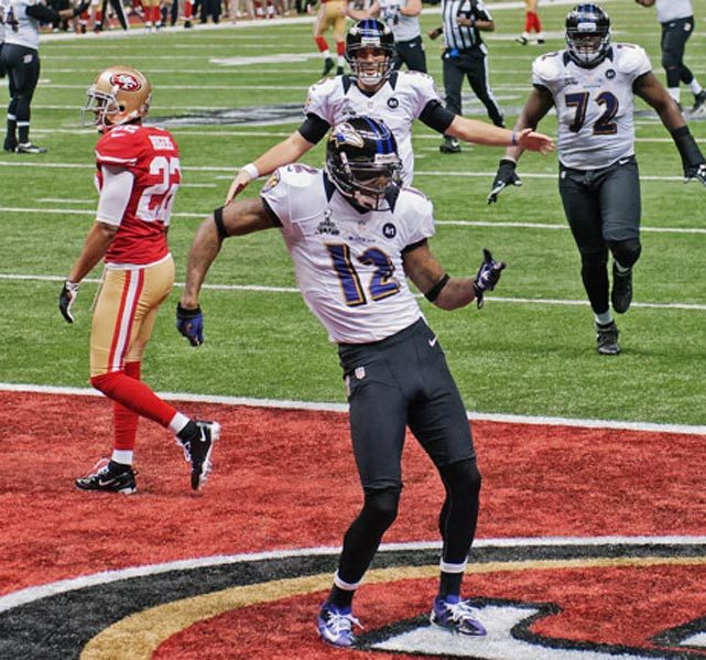 Ravens receiver Jacoby Jones celebrates after scoring on a 56-yard touchdown reception. Jones also scored on a 108-yard kickoff return to start the second half in leading Baltimore to a 34-31 Super Bowl victory over San Francisco. (David Bergman/SI) GALLERY: SI's Best Super Bowl Photos | Super Bowl Fans