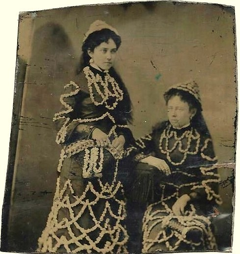 ca. 1880-90's, [tintype portrait of two women adorned with stringed popcorn and possibly peanuts] via Ebay
