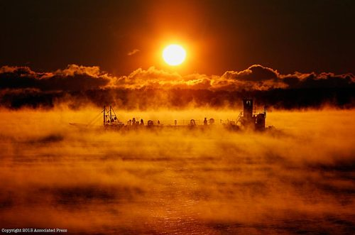 paid2see:  Sea Smoke. AP's Maine based photographer Robert Bukaty was up before the sun this morning and out in the elements to make this cold weather feature at the Portland Harbor of barge motoring through the sea smoke caused by the sub-freezing weather. Robert is legendary in The AP for his abilities to use natural light to craft a stunning news photo. Technical info on how this was shot will be coming as soon as Robert thaws out.