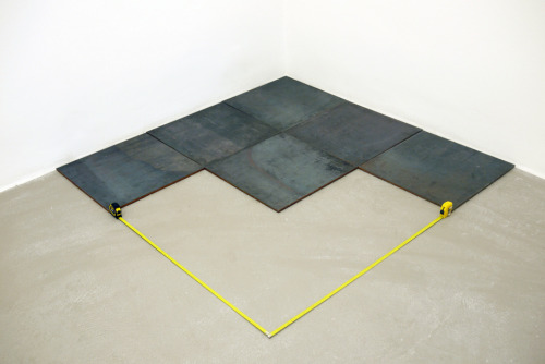therealjimricks:  Carl Andre, 3rd Steel Triangle, 2008 with Ahmet Ögüt, intervention of 2 tape measures, 2011