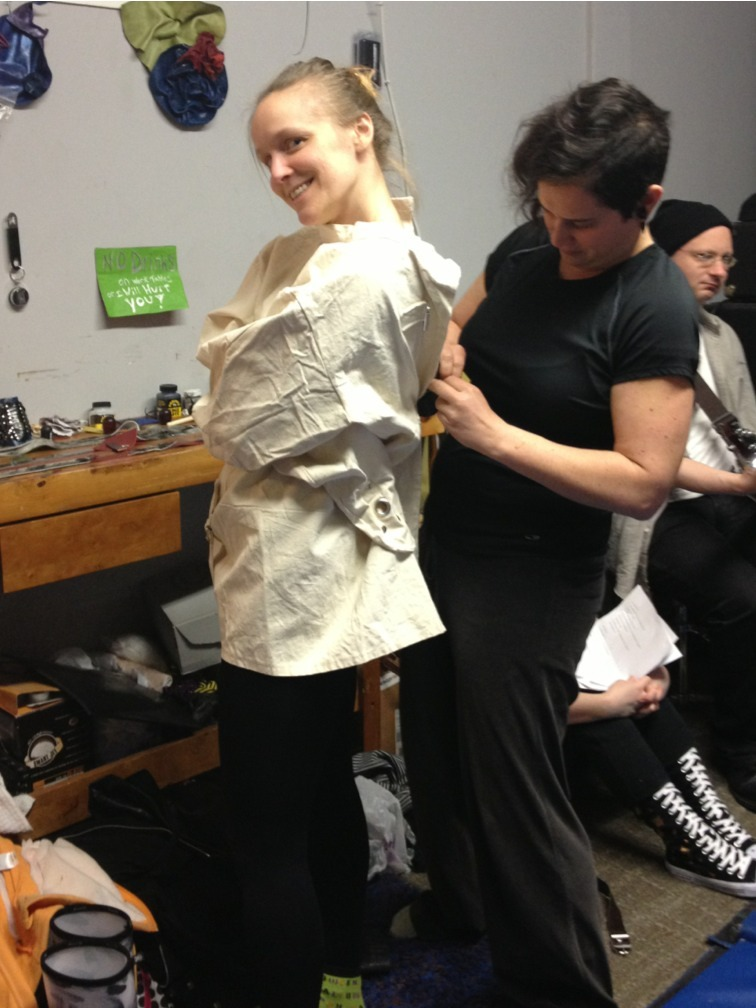 Susie Skrew getting her straight jacket fitted for Saturday.
