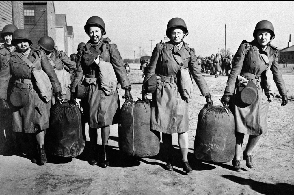 Women carry bags as they prepare to leave the U.S. for North Africa in this Jan. 29, 1943, photo provided by the U.S. Army. They were part of the first detachment of the Women's Auxiliary Army Corps to be sent abroad.