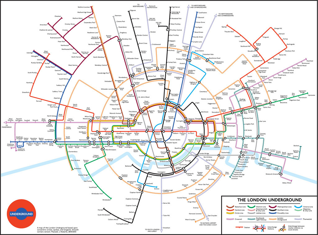 "Unofficial Map: Circular Tube Map by Maxwell Roberts Apparently, circular Tube Maps are like London buses — none come forever, then two arrive at the same time. This one is by Maxwell Roberts, an expert on the London Underground map if there ever was one. He's personally redrawn multiple, multiple versions of the map in just about every possible configuration, just to see what works and what doesn't. Many are featured in his excellent book, Underground Maps Unravelled, which I promise I'll review properly one day. Wisely, Roberts has confined his map to the traditional view of Greater London itself, with trains headed to distant places given an arrow pointer towards that destination. Interestingly, most of his route lines radiate out from a central point, but some run parallel to other routes instead. This makes the design less rigid to a design ideal, but also upsets the visual flow of the diagram in a couple of places — I find the parallel Bakerloo and Metropolitan Lines in the northwest part of the map quite jarring. Roberts' interchange stations are much tighter than Fisher's, looking far more like ""traditional"" Tube Map markers, but some are still very convoluted in making their connections between lines, such as at Farringdon/Barbican. The London Underground logo ""hidden"" in the Circle Line is a bit of a gimmicky design affectation, although it actually works surprisingly well in the context of the diagram. Overall, I think this version is more successful than Jonny Fisher's, although I still don't really see it as a viable alternative to the current official map. Neither does Mr. Roberts, who says, ""Overall though, I don't think I will be sending this one to TfL for comments. No great advances in usability here, but it was fun to make it."" Three-and-a-half stars.  (Source: Going Underground blog — click through for more detailed analysis from Maxwell Roberts himself)"