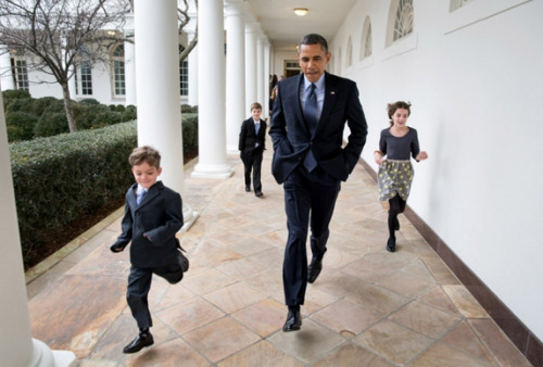 President Barack Obama runs along the Colonnade of the White House with Deputy National Security Advisor Denis McDonough's children, Jan. 25, 2013. The President announced McDonough will become Chief of Staff, replacing Jack Lew, the nominee for Treasury Secretary. (Official White House Photo by Pete Souza)