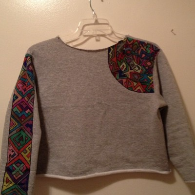 One of a kind hand painted tribal design, cropped sweatshirt. Fits Ladies M/L $10 message me if you would like to order this one or if you would like a custom hand painted tee or sweatshirt made just for you! Prices vary. Www.facebook.com/servingourpurpose