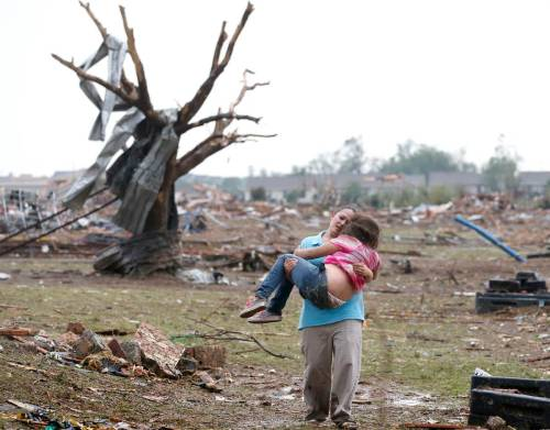 "UPDATE: At least 51 killed as tornado tears through Oklahoma NBC News:  At least 51 people have died after a monster tornado roared through Oklahoma City suburbs Monday, destroying homes, tearing the walls off an elementary school and leaving behind mangled cars and splintered wood.  ""The whole city looks like a debris field,"" says Mayor Glenn Lewis of the city of Moore, which appears to have been the hardest hit. Continue following updates on BreakingNews.com."