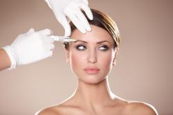BOTOX FOR DEPRESSION? For years, Botox has been a savior to women longing to freeze time, pun intended. It's a quick and easy way to recapture the porcelain days of youth. However, Botox has also gained popularity for its medical uses, such as treating neck pain, eye twitching, crossed eyes and muscle stiffness. Arguably the most interesting recent use for Botox is using it to combat severe clinical depression. The Daily Mail reported that recent studies have discovered that injecting Botox into frown lines can drastically improve your mood. Scientists concluded that when people physically stop frowning (which can trigger negative emotions), they feel better. In a clinical study, researchers found that when the effects of the Botox wore off, depression symptoms returned. There is clearly a correlation there. The FDA recently approved Botox as a treatment for chronic migraines and headaches. Now that's not to say that a dermatologist visit should replace a Tylenol, but if it is an ongoing and severe problem, Botox could be a viable solution. It is injected into seven different sites on the head and neck, dulling the symptoms that accompany massive headaches. Botox has also come to the rescue for people with severe perspiration problems and sweaty palms and feet. It can be injected into the problem areas to stop the glands from producing secretions, blocking the nerve supply in the sweat glands, effectively reducing perspiration. Who says that vanity can't contribute to medicine? Photo credit