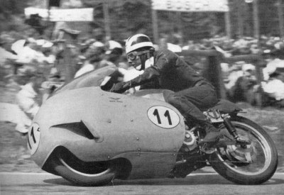 alfonslx2:  Bill Lomas with Guzzi 500 8 cylinders in the 1956 German Grand Prix played at the Solitude circuit, located in the vicinity of Stuttgart