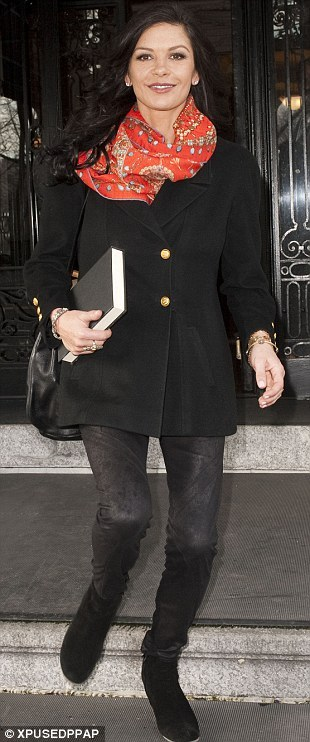 Celebrity Scarf Watch: Catherine Zeta-Jones wearing a red printed silk scarf outside her New York apartment. Fabulous colour on her, which lifts an otherwise plain outfit.