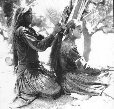 Wickware Boisseau / ruthhopkins: Navajo (Diné) mother tying her...