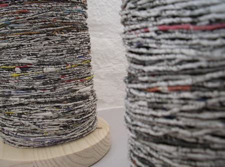 Yarn from newspapers. Brings a whole new meaning to media spin. Wish I could do this!
