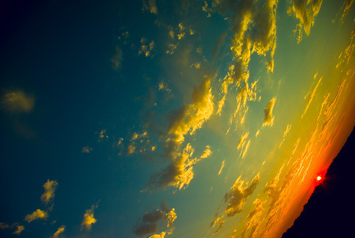 Sweet photograph of the sky during sunset. I'm not sure if it is photo manipulated or not.  I like how the photographer got me confused at first when I saw this picture.  I thought I was looking out from space.  Nice angle manipulation. (via gatekeeper)