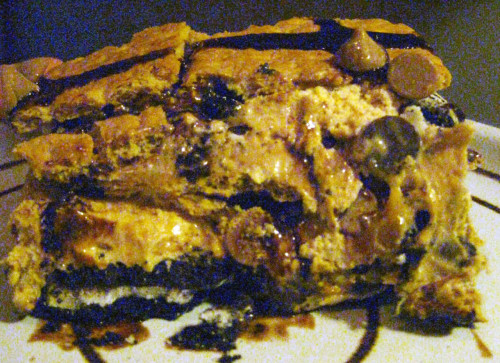 thisiswhyyourefat:  Dessert Lasagna Layers of Oreos, graham crackers, dulce de leche ice cream, chocolate and peanut butter chips drizzled with chocolate syrup. (Submitted by Erin Shea and Emily Axford via redpajamas)