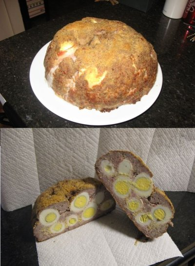 thisiswhyyourefat:  The Scotch MegaEgg 20 hard-boiled eggs wrapped in bacon and covered in sausage meat and breading, baked whole.