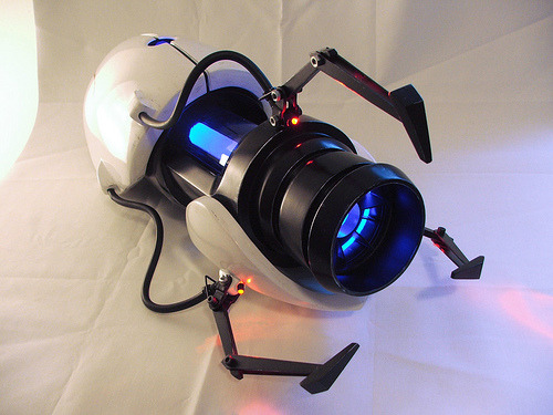 Home Made Aperture Science Handheld Portal Device This is certainly a triumph.  Everyone make a note here, huge success.  This replica portal gun was made by a guy for his girlfriends new Aperture Science test subject costume.  Though it looks large in the picture its only 22 inches long and about as tall as a bottle of Red Stripe.  Good work.  Very good work. [Flickr]