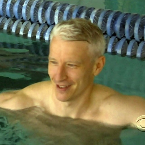 Superherofan got some shirtless caps from Anderson Cooper's inteview with Michael Phelps that I talked about the other day.  Anderson doesn't show much but beggars can't be choosers.  LOL