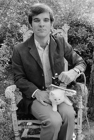 Steve Martin ironing a kitten. TRUE FACT: Steve once had a cat named Dr. Carlton Forbes.  Basically the coolest cat name ever.