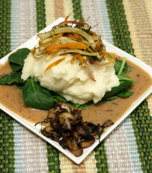 via organicpixel Whipped potatoes on a bed of spinach over savory sauce, topped with sautéed fennel, orange sweet peppers and red onions, with a side of sautéed mushrooms.