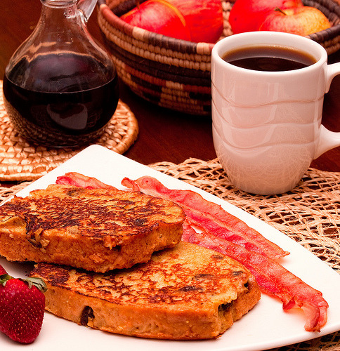 (via Walter_Ezell) French toast made with buttermilk, cinnamon and home-made raisin bread, cooked in butter and drenched with cranberry-maple syrup.