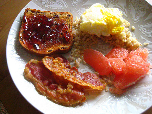 (via Happy Jack Eats) Bacon, jelly on toast, egg and rice, and grapefruit.