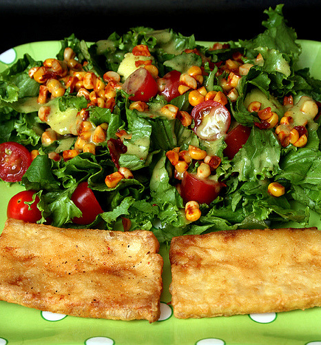 (via autumnappeal) Beer battered tofu and chipotle corn salad with cilantro lime dressing.
