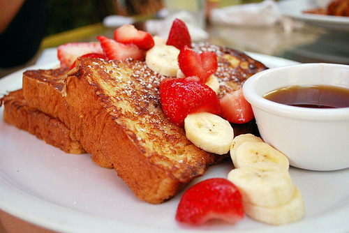 (via esthereggy) French toast with fresh strawberries and bananas