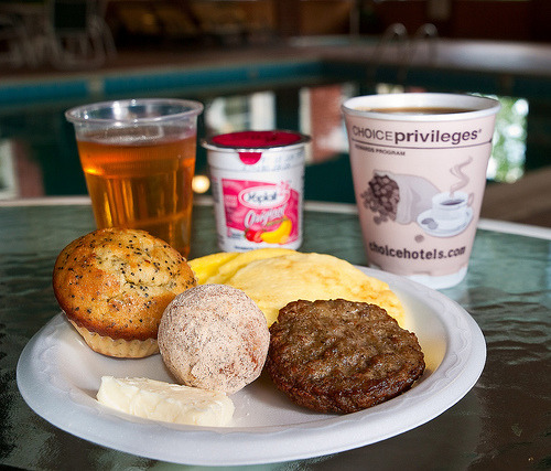(via Walter_Ezell) Eggs, sausage, muffin, donut, yogurt.