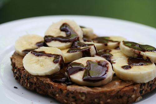gluttonyisabliss:  (via Loren Worsley) Bananas with peanut butter and chocolate sauce on toast.