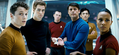 Weekend at the Movies: Sci-Fi Double Feature (part 1)  Star Trek Let me just preface this by saying I am in no way a Trekkie, as explained here. While the exposure has always been there, for whatever reason, I never chose to indulge in the franchise. But this didn't stop me from watching Star Trek and enjoying a great experience. The question is - does it accomplish its mission in recruiting a new fan? The opening scene of the film is important in ways not immediately noticeable. It serves as a chisel to the plot and to our main character. A massive Romulan spacecraft commandeers the USS Kelvin. The Romulan captain is Nero, played unrecognizably by Eric Bana, and he is searching for Spock. No reason is given, but his anger is palpable. After the Romulans ascertain information from the Kelvin's captain, their menace is displayed; laying waste to the unmatched starship. George Kirk, next in command after Captain Robau is murdered, is able to heroically evacuate 800 people in 12 minutes, including his pregnant wife on the verge oflabor, prior to his death.  (pics courtesy of EW) We are introduced to the film in an engrossing visual spectacle - the way modern sci-fi cinema should be. But the effects in this film, and what you see in trailers, though breathtaking, does not define what Star Trek is about. It is character-driven to its core - and the two principle protagonists, Kirk and Spock, do an amazing job piloting. Chris Pine, as James Kirk, terrifically infuses self-assured swagger, vehement ambition and nauseating ego to a character that displays the potential to be a leader of men, but the overbearing immaturity that can get him banished from a starship. Even better was Zachary Quinto, who portrays Spock, the most fascinating character in the film. Quinto tremendously embodies reason/logic in a tact and self-righteous manner, and balances it all with the tormenting inner conflict any half Vulcan, half human, faces in trying to suppress emotions. The movie is best when these two characters share screen time - whether as a team or at each other's throats. Their development is the best thing about Star Trek.  The rest of the Enterprise crew - Uhura, McCoy, Scotty, Sulu, Chekov - all have their special moment to shine. But the character with the most pivotal moment, not only in the film, but in shaping how the story of this franchise can be told in the future, is Star Trek's worst kept secret. Still, for the sheer spirit of surprises, I won't spoil who this character is or the plot that surrounds them. I'll just expand vaguely on their importance. By introducing this character the way they did (I can't comment on how plausible/implausible things can be in a universe I know nothing of), the writers were able to start with a blank slate with the entire franchise. This allows J.J. Abrams the freedom to be able to satisfy the most dedicated of fans, at the same time incorporate his own brand of narrative that appeals to this generation. The execution was great in my opinion (paradox aside, of course) and future installments will benefit from this reinvention.  An epic ride is not without its bumps. Nero is quite underused. His development takes a backseat to the introduction needed for the main characters. The Romulans in general, while we feel for their plight, come off as the typical, one-dimensional, revenge hungry villains we see in a lot of films. The lighting was also an issue for me, especially in those compact, shifting shots inside the bridge of the Enterprise. They would produce a lot of annoying glares. Now, I didn't see the IMax version, so I don't know if these lighting effects were compliments to 3D glasses only, but I wasn't fond of being blinded. There really isn't a good reason why I never hopped aboard the Star Trek starship (see what I did there?) in my life. But J.J. Abrams and company did a fantastic job of introducing the story in a very accessible way to noobs such as myself. Obviously, I can't speak for the diehard Trekkies on whether or not this film succeeded in capturing whatever expectations they had. It did, however, succeed in giving birth to a potential Trekkie. I find myself more eager to educate myself on Star Trek lore. And in that regard - mission accomplished.  (cross posted at Otakuberries)