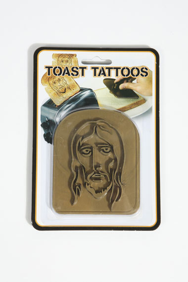 friendlyatheist:  northerndelight: Jesus Toast Tattoo via Urban Outfitters  He is literally on the bread we eat now. We can break him on every meal. I'm gonna see if i can get my Pastor to do this for communion. We can put jelly on it and that would be a perfect wine and bread combo for communion.