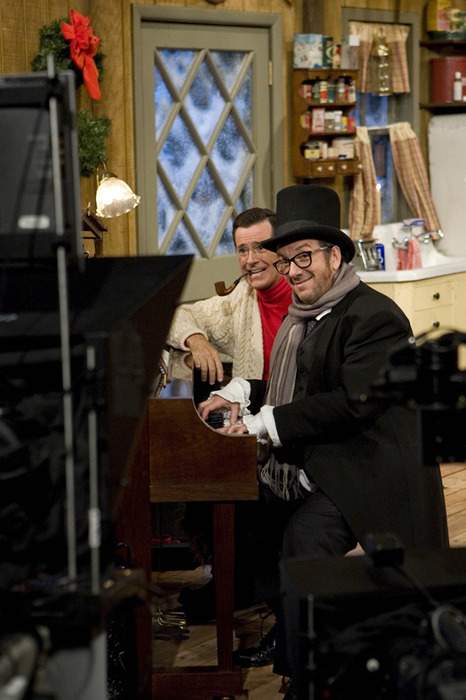 "sayyes:  gaelen: Feist, Elvis Costello Do Christmas With Stephen Colbert | Pitchfork In the special, Colbert is on his way to meet with Elvis Costello in New York City but is snowed-in at his cabin in upstate New York (bear country). He weathers through the storm with help from his friends Feist, Toby Keith, John Legend, Willie Nelson, and Jon Stewart. a.k.a. ""One snowy evening I got some beer for my horses and then we all got sooooooo hiiiiiiiiigh, dude!"" a.k.a. AWESOME"