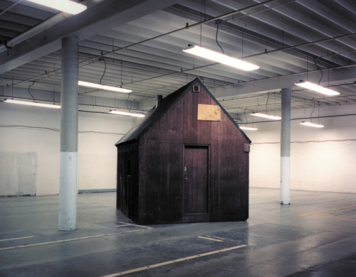 "dailymeh:  The Unabomber's cabin, sitting in an FBI storage facility on an airforce base in Sacramento, photographed by Richard Barnes. Sure looks out of its element; as Barnes says, ""the cabin represents a particularly American ideal of rural self sufficiency and independence gone horribly awry"", and its context is sort of the opposite of that. I wonder if it still sits there, waiting."