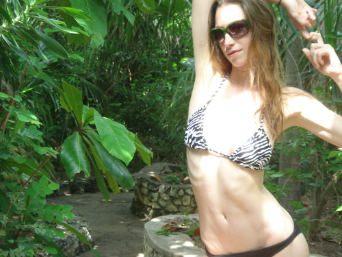 "tarastiles: Doing some jungle move that seemed right at the time in Jamaica. If I may make a recommendation - go to Strala Yoga. It's the most laid-back, down-to-earth, no om-ing, free fruit-having, ass-kicking studio I've ever been to.* If that's not enough, the owner and main teacher is my buddy Tara Stiles, who may or may not be kind of a big deal. (At least Vanity Fair thinks so…) And if that's not enough to get you there, then at the very least, follow her Tumblr. She's a ball of fun. She's also great at handstands. (And taking hot bikini photos.) *I've only been to like 2 yoga studios in my life, but the fact that I've found myself dedicated to some form of physical activity should speak mountains. (Is ""speak mountains"" even a saying? Or did I just make that up? Whatever, you get the point.)"