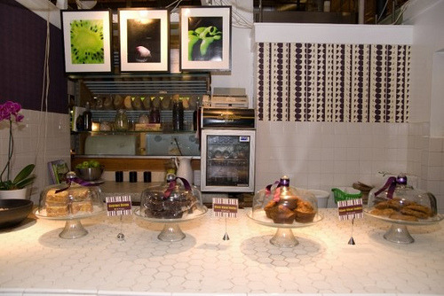 The New Look  Basic 4 Vegetarian Cafe has a new look. We have transformed the space into a casual and comfortable dining space, infused with a sleek modern feel using the companies color scheme of eggplant purple and apple green. Using steel, glass, pottery and simple accessories, the aesthetic is both classic and current, elegant and fresh. Stop by and check out the new look.