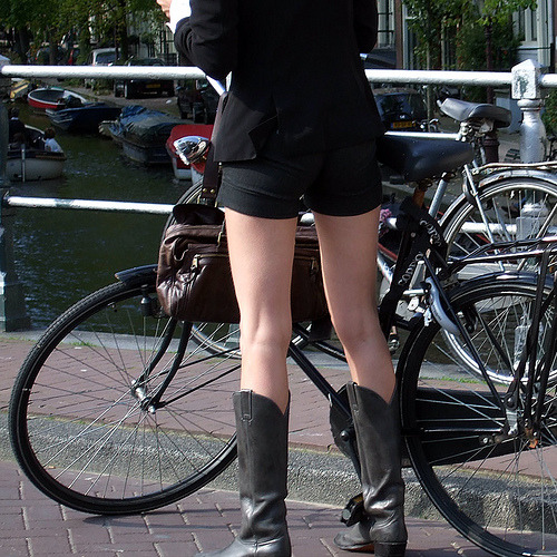 Untitled girl with great legs considering getting on her bicycle one. Swiped from Flickr.