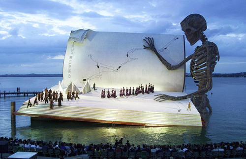"The stage at Austrian Bregenzer Festspiele's 1999 production of Verdi' s opera ""A Masked Ball"" was a giant book being    read by a skeleton . (I had to dig for this because the original poster just put up the image with no context. Shame on your laziness.) booklover:meanoldpotato:iheartmyart:mazes"