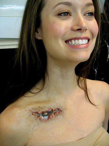 Summer Glau showing of EndoSkeleton (via Jungleboy) SHe's got white teeth, a nice smile, and a freaking awesome metal body