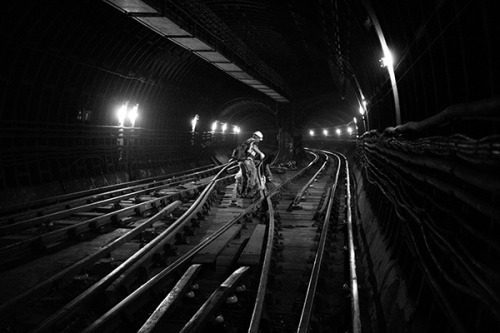 """An engineer prepares for the night ahead in a tunnel underneath Hampstead tube station, the deepest station on the network"". Photo by Frantzesco Kangaris."