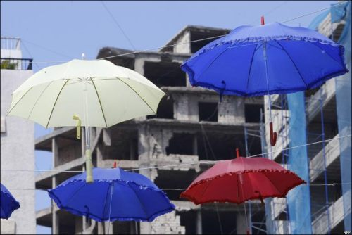 "More than 1,000 umbrellas adorn a street in the Lebanese capital Beirut to mark the start of the promotional ""shopping month"". Photo by Ramzi Haidar, from the BBC News Day in pictures."