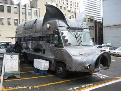 Maximus Minimus (via OC Weekly -Edwin Goei)  Road-Warrior-Meets-Babe-The-Pig Death Van is only found in Seattle, where I just happened to be last Labor Day weekend.  I wasn't looking for it.  It kind of just found me.  And when something like this crosses your path, as it did that rainy afternoon, you stop and you take a picture.  http://blogs.ocweekly.com/stickaforkinit/news/a-grilled-cheese-truck-coming/