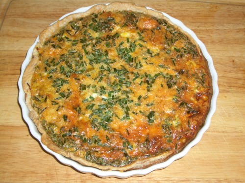 "I know when you hear 'quiche' you think 'sissy girlie food'. I'm not going to touch that one with a 10-foot pole. Just try it. It's good. And it's easy. And it's extremely versitile. If you don't have or like zucchinni, use a squash. Or even tomato. Maybe asparagus instead of broccoli? Want mushrooms instead of carrots? No problem.Black olives more your thing? Throw 'em in. If this isn't filling enough, you can add 1 Russett potato, scrubbed and cut into .25"" cubes. Don't have an onion? Use .25c dried minced onions, reconstituted.  Garden Veggie Quiche 1 frozen pie crust1 medium onion, chopped finely or grated1 bell pepper, chopped1 small head broccoli cut into flowerettes1 small zucchini peeled and grated1 large carrot sliced thinly2 tablespoons butter2 cloves garlic, mashedsalt and pepper to taste1Tbsp dried dill.75 cup mixed shredded cheeses (I like the pre-packaged Mexican cheese blend)5 eggs.25 cup milk2-3Tbsp of fresh snipped chives or garlic chives, sliced or snipped finely.  Line a 9 inch pie pan with the defrosted pie crust. Cover the crust with 2 sheets of aluminum foil. Bake at 450 degrees for 5 minutes. Remove the foil and bake another 5 minutes. Place on a rack or thick wooden cutting board and let cool while preparing remaining ingredients. In large skillet, melt butter. Add veggies except for garlic and chives. Sweat the veggies until they are soft.  Add your garlic and mix well. Remove from heat.  Spoon your vegetables into the partially-baked crust.  Top with the shredded cheese. In a medium bow, whisk together eggs, milk, salt, pepper, chives and dill. Pour over vegetables.  Bake at 350 degrees for 30 to 45 minutes or until a knife inserted near center comes out clean.  If edges start to get too brown, cover edges with foil during baking.  Let stand at least 5 minutes before slicing. Serve hot or at room temperature."