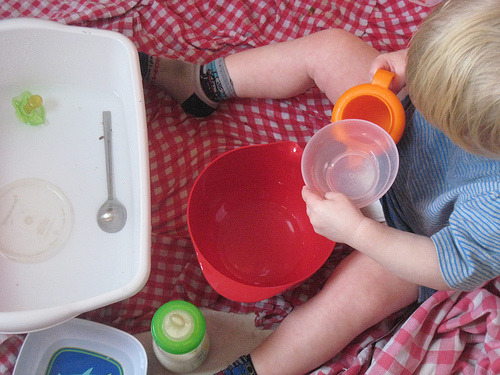 Water play is a simple indoor fun activity. Pouring and transfer fun is child's work. Learning is everywhere.