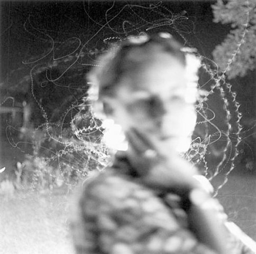 Edith and Moth Flight / a b&w fotograf by Emmet Gowin, 2002