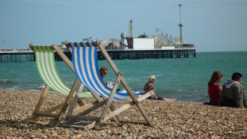 :  OO1 WORLD: LONDON EXPLORE: Brighton Beach Less then an hour away from London Victoria Station, this Victorian seaside town is the perfect city escape. Rent a lounge chair on the rocky beach overlooking the pier and enjoy some fish and chips