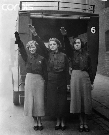 """Three female blackshirts, members of the British Union of Fascists, salute as they leave their Chelsea headquarters for Birmingham, where they will attend a meeting addressed by their leader, Oswald Mosley."" 1934 Pic via Corbis here"