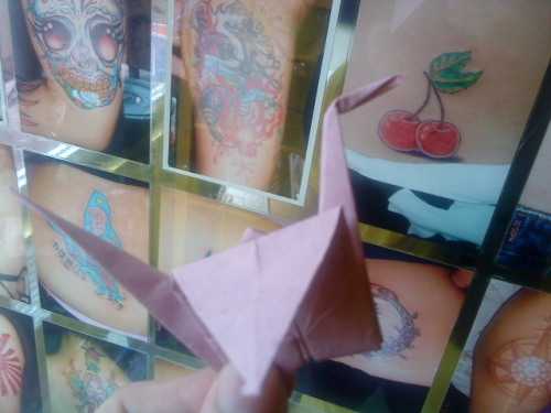 Crane #78 At the tattoo parlor, where a lot of things get tattooed on your mind.  Designs, patriots, yellow submarines, and the Ouroboros on Fritz's back.