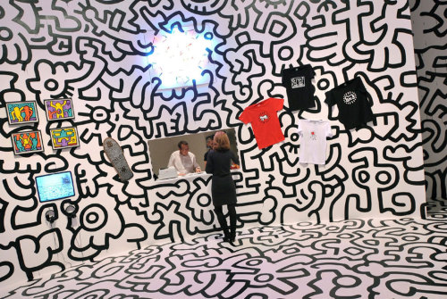 Keith Haring installation at Tate Modern  Pop Life: Art in a Material World proposes a re-reading of one of the major legacies of Pop Art. The exhibition takes Andy Warhol's notorious provocation that 'good business is the best art' as a starting point in reconsidering the legacy of Pop Art and the influence of the movement's chief protagonist. Pop Life: Art in a Material World looks ahead to the various ways that artists since the 1980s have engaged with mass media and cultivated artistic personas creating their own signature 'brands'. Among the artists represented are Tracey Emin, Keith Haring, Damien Hirst, Martin Kippenberger, Jeff Koons, Takashi Murakami and Richard Prince.  If you happen to be in London* it opens today.  I would take a gander if I were in the neighborhood.  But that's just me.  *Lucky bastard.