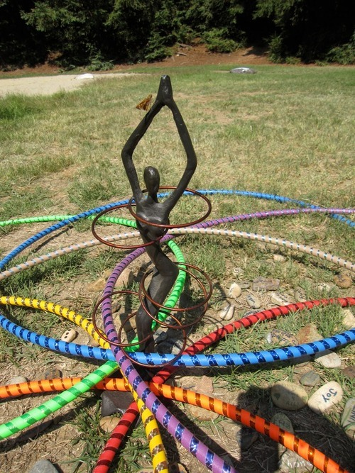 "Hoop Mandala:   When we arrived at Hoop Camp we were given a stone to write our intentions on.  During the opening ceremony we shared our intention for this weekend and then placed our rock in this hoop mandala.  My intention for the weekend was ""Friendship.""  I wanted to spend the weekend getting to know fellow hoopers.  At previous hoop retreats I felt nervous about meeting others and feel like it sheltered me from making more friends.  This time I had a blast, met tons of great people and feel like I really had the chance to connect!"
